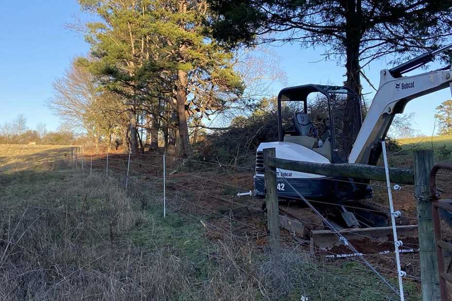 Excavator Fence Clearing